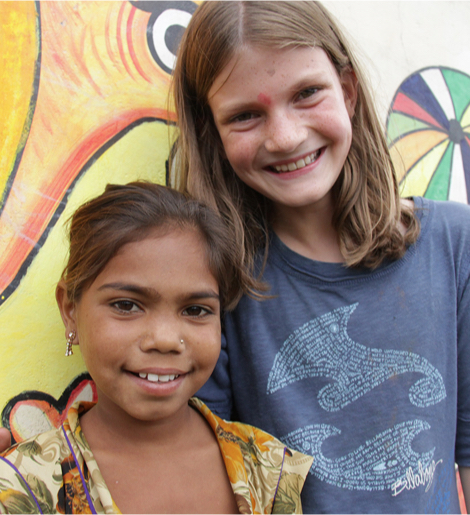 A volunteer with a young girl in India