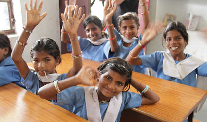 Indian kids smiling in a classroom