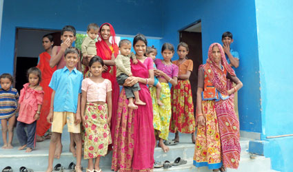 Indian families standing in fron of the hospital