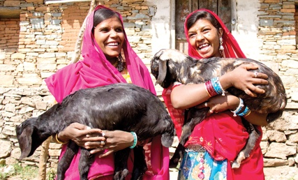 girls with goats