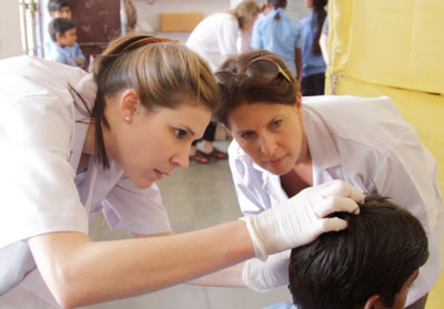 Doctors examining school kids