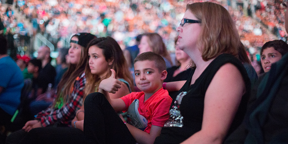 A family sits together at WE Day