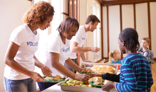 Volunteers serving meals at an event