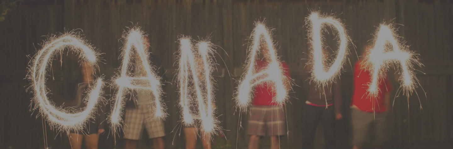Canada spelled out by people with sparklers