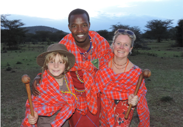Two travellers and a Massai warrior