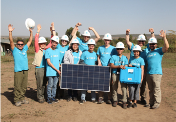 A corporate team working with solar technology