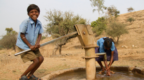 Kids using hand pump