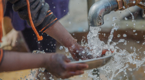 Child accessing clean water from a tap