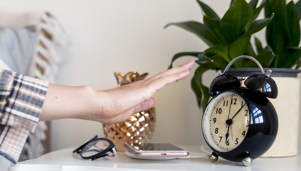 Hand setting an alarm clock