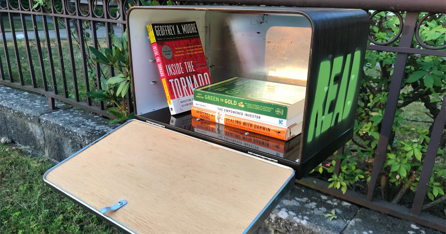"The Caos' book exchange encourages passersby to take a book or leave a book for the community to share. Alicia and Christopher found the materials needed to build the little ""library"" for free online."