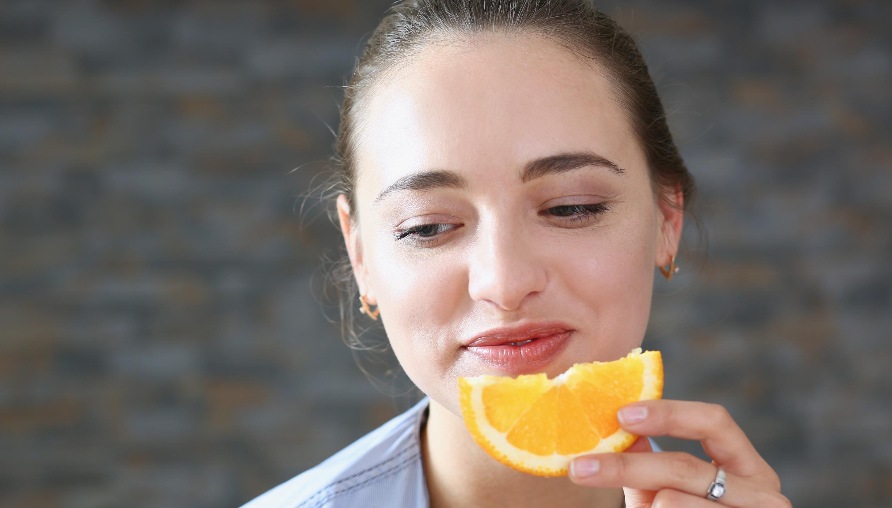 lady eating orange