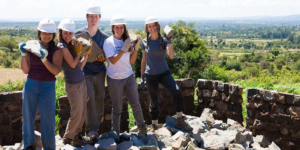 Volunteers building a school