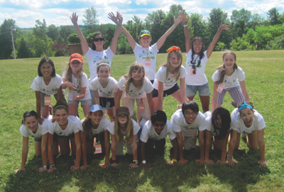 Campers forming a human pyramid