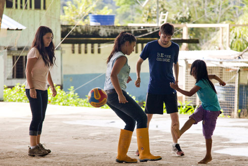 Travellers playing soccer with students in the Amazon, Ecuador