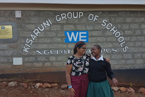 Traveller with a student at Kisaruni Group of Schools in Kenya