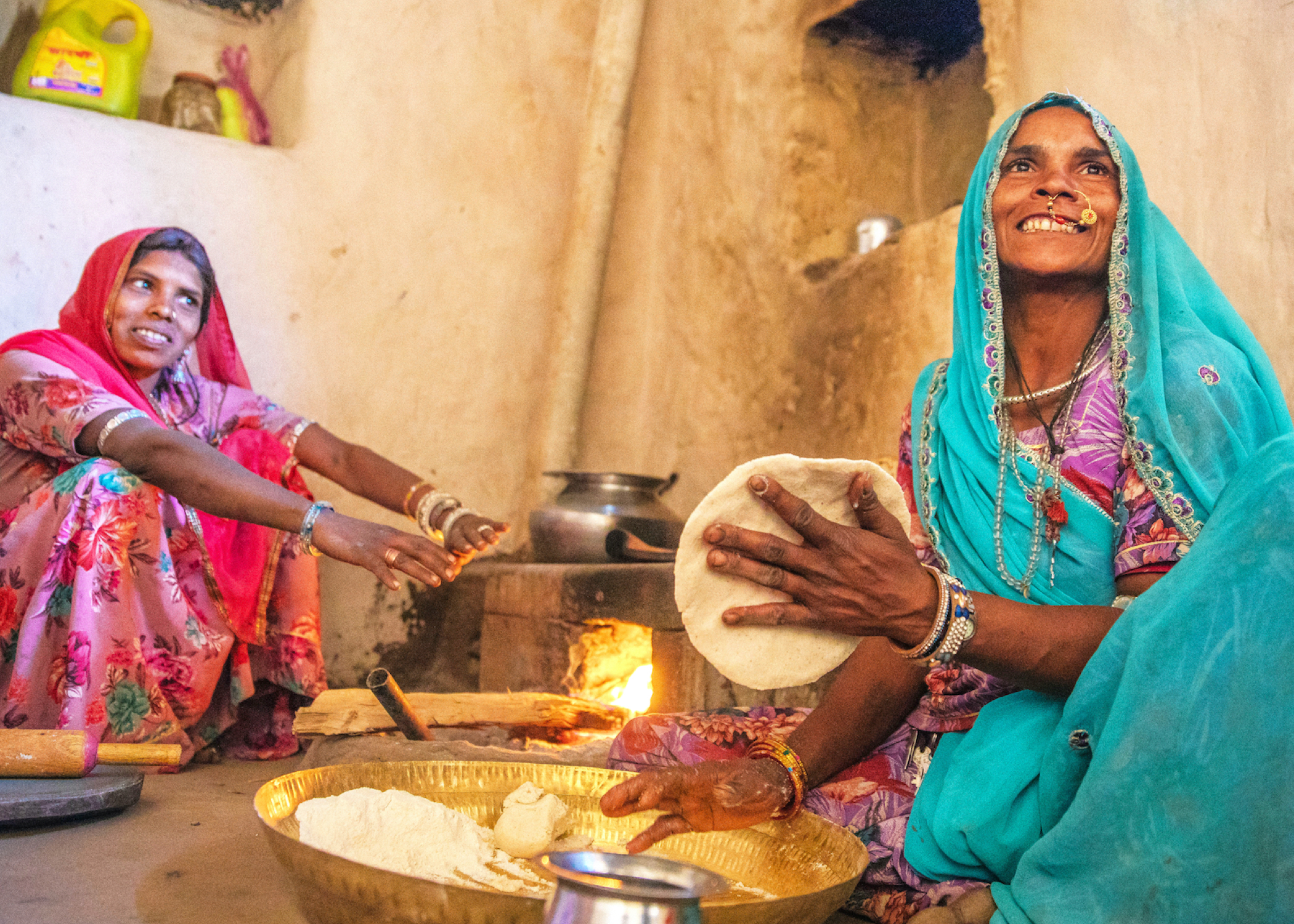 Two women cooking Chapati